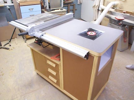 Improve your router table with these tips from binks woodworking after i finished my sawing router center i needed to add a few options to my new router table i needed a miter slot cut into the table and find a way greentooth Choice Image